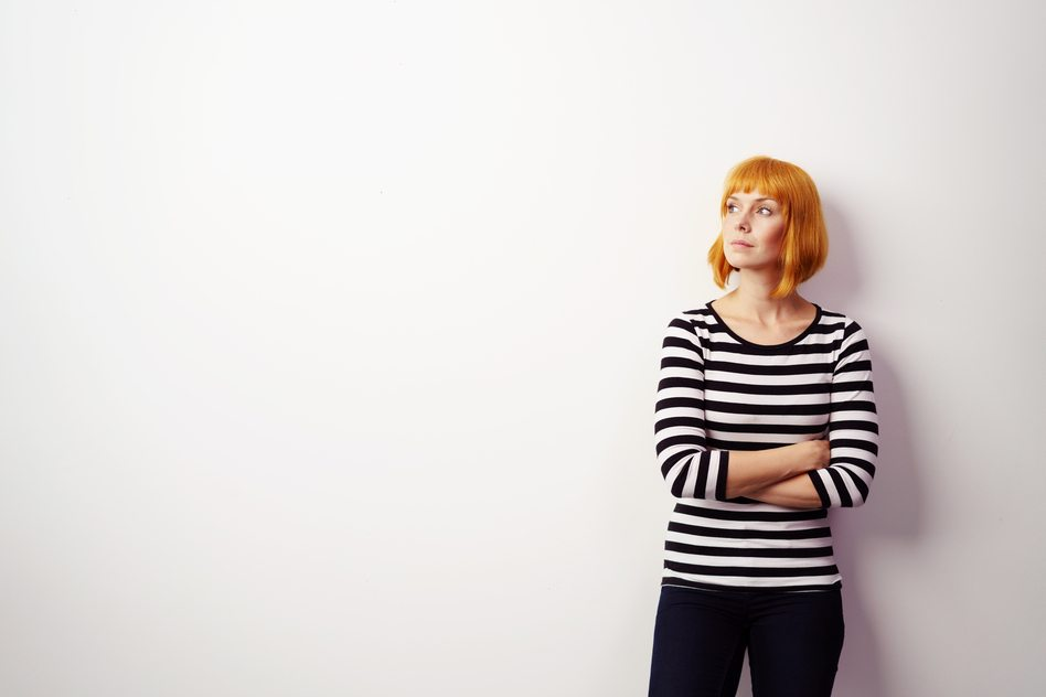 Angry woman wearing striped shirt and black pants