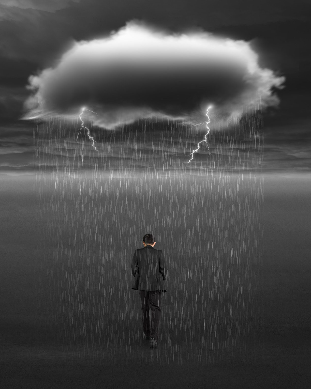 Depressed businessman walking with dark cloud of rain and lightning